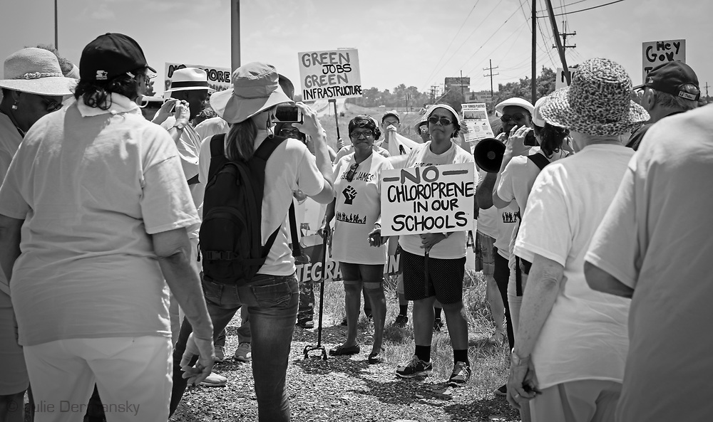 """Sharon Lavinge and others at the approach to the Sunshine Bridge in St. James Louisaina on the third day of a five day march through Louisiana's 'Cancer Alley' held by the Coalition Against Death Alley. The Coalition Against Death Alley (CADA), is a group of Louisiana-based residents and members of various local and state organizations, is calling for a stop to the construction of new petrochemical plants and the passing of stricter regulations on existing industry in the area that include the groups RISE St. James, Justice and Beyond, the Louisiana Bucket Brigade, 350 New Orleans, and the Concerned Citizens of St. John  Louisiana's Cancer Alley, an 80-mile stretch along the Mississippi River, is also known as the """"Petrochemical Corridor,"""" where there are over 100 petrochemical plants and refineries . The Coalition was denied a permit to march over the Sunshine Bridge and the I-10 Bridge."""
