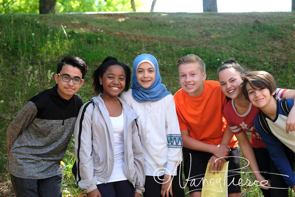 These pictures were taken at JT Williams Secondary Montessori School.  These students were chosen by me to be photographed. They're middle school students,