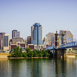 Photo of Cincinnati skyline, John A. Roebling bridge, and downtown city office buildings including Great American Insurance Group Tower, Omnicare building, Scripps Center building, PNC Tower Building, Carew Tower, US Bank Building, and Fifth Third Bank building. Photo is high resolution and was taken in July 2012.
