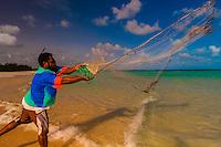 "Local Kanak (Melanesian) man casting a fishing net (in French ""Epervier"", hawk net), Mouli, Island of Ouvea, Loyalty Islands, New Caledonia"