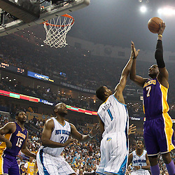April 24, 2011; New Orleans, LA, USA; Los Angeles Lakers power forward Lamar Odom (7) shoots over New Orleans Hornets small forward Trevor Ariza (1) during the first quarter in game four of the first round of the 2011 NBA playoffs at the New Orleans Arena.    Mandatory Credit: Derick E. Hingle