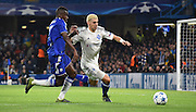 Aleksandar Dragovic with the sliding challenge on Ramires during the Champions League group stage match between Chelsea and Dynamo Kiev at Stamford Bridge, London, England on 4 November 2015. Photo by Michael Hulf.