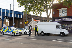 © Licensed to London News Pictures. 08/08/2019. London, UK.  Police and a van at the scene in Leyton this morning in Leyton High Road, where a police officer has been left in a critical condition after being stabbed repeatedly whilst attempting to stop a van in east London. The injured Police Officer, believed to be aged in his thirties, was rushed to hospital and is in a critical but stable condition..  Photo credit: Vickie Flores/LNP