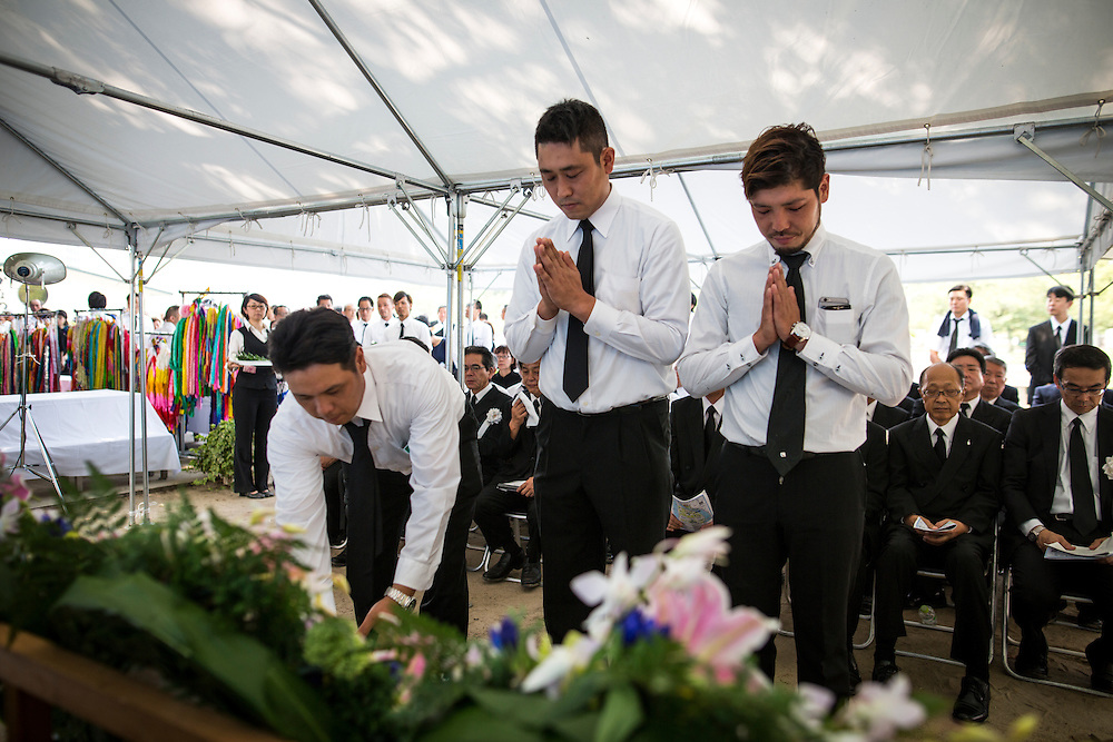 """HIROSHIMA, JAPAN - AUGUST 5 : People lays flowers and pray for all the construction workers, craftsmen, staff members who died in the war ahead of the 71st anniversary of the atomic bombing on Hiroshima at the Hiroshima Peace Memorial Park in Hiroshima, western Japan, Friday, August 5, 2016. Japan will mark the 71st anniversary of the atomic bombing on Hiroshima. On August 6, 1945, during World War II, the United States dropped a uranium gun-type atomic bomb named """"Little Boy"""" on the city of Hiroshima which instantly killed an estimated 80,000 people, tens of thousands more would later die of radiation exposure. Three days later, a second American B-29 bomber dropped a plutonium implosion-type bomb """"Fat Man"""" on Nagasaki, killing an estimated 40,000 people. (Photo: Richard Atrero de Guzman/NURPhoto)"""