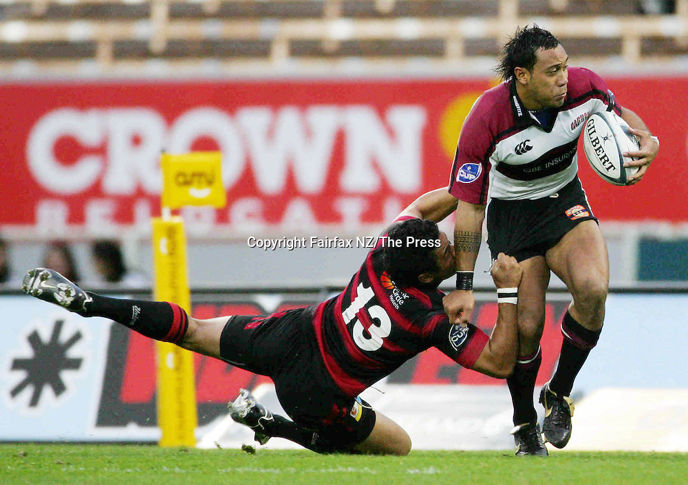 North Harbour center Anthony Tuitavake leaves his opposite Casey Laulala  stretched in the Ranfurly Shield match played at Jade Stadium in Christchurch on Sunday. North Harbour won the shield from Canterbury, beating them 21-17 for the first time in the history of the province, and after failing in 10 previous attempts.
