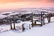 Snow-covered view from Swyre Head towards Kimmeridge Bay. Dorset, UK.