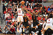 LUBBOCK, TX - MARCH 1: Keenan Evans #12 of the Texas Tech Red Raiders shoots the ball over Kendal Yancy #5 of the Texas Longhorns during the game on March 1, 2017 at United Supermarkets Arena in Lubbock, Texas. Texas Tech defeated Texas 67-57. (Photo by John Weast/Getty Images) *** Local Caption *** Keenan Evans;Kendal Yancy