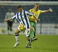 Photo: Aidan Ellis.<br /> Huddersfield Town v Swansea City. Coca Cola League 1. 30/12/2006.<br /> Swansea's Thomas Butler challenges Huddersfield's Chris Brandon