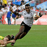 Fiji's Jerry Tuwai steps out of the grasp of an Australian defender in the Singapore 7's Cup Final at Singapore National Stadium, Singapore, Singapore.  Fiji won the Singapore 7's 2018 Championship with a 28-22 victory over Australia, coming from behind with no time remaining.  Photo by Barry Markowitz, 4/29/18, 9pm