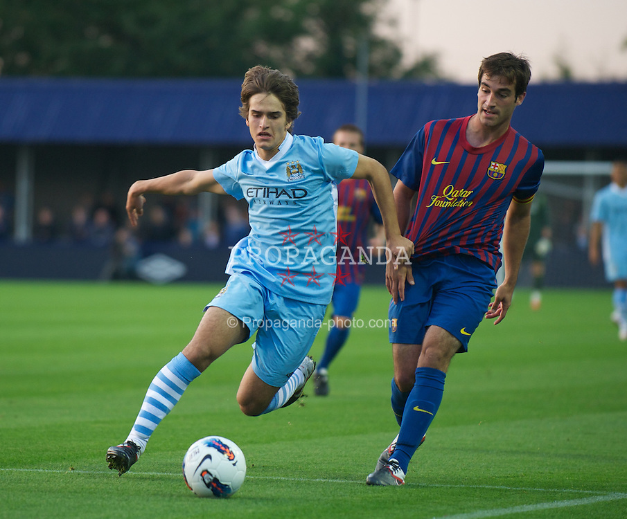 HYDE, ENGLAND - Thursday, September 15, 2011: Manchester City's Dennis Suarez and FC Barcelona's Eduard Campabadal during the NextGen Series Group 1 match at Ewen Fields. (Pic by David Rawcliffe/Propaganda)