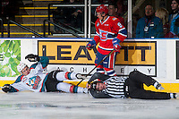 KELOWNA, CANADA - JANUARY 4: Keanu Yamamoto #9 of the Spokane Chiefs checks Conner Bruggen-Cate #20 of the Kelowna Rockets and takes down linesman Tim Plamondon in the process on January 4, 2017 at Prospera Place in Kelowna, British Columbia, Canada.  (Photo by Marissa Baecker/Shoot the Breeze)  *** Local Caption ***