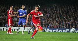 Xabi Alonso scores Liverpool's 2nd goal during the UEFA Champions League Quarter Final Second Leg match between Chelsea and Liverpool at Stamford Bridge on April 14, 2009 in London, England.