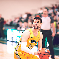 5th year forward, Kornel Tokolyi (12) of the Regina Cougars during the Men's Basketball Home Game on Fri Feb 01 at Centre for Kinesiology,Health and Sport. Credit: Arthur Ward/Arthur Images