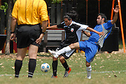 Jose Ceballos (center) of Deportivo Colomex competes for control of the ball while competing with Team Shlama F.C. during National Soccer League play in Skokie, Il.
