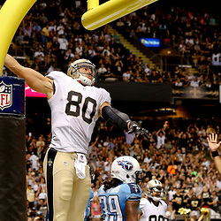 Aug 15, 2014; New Orleans, LA, USA; New Orleans Saints tight end Jimmy Graham (80) dunks over the goal post following a touchdown against the Tennessee Titans during a preseason game at Mercedes-Benz Superdome. Mandatory Credit: Derick E. Hingle-USA TODAY Sports