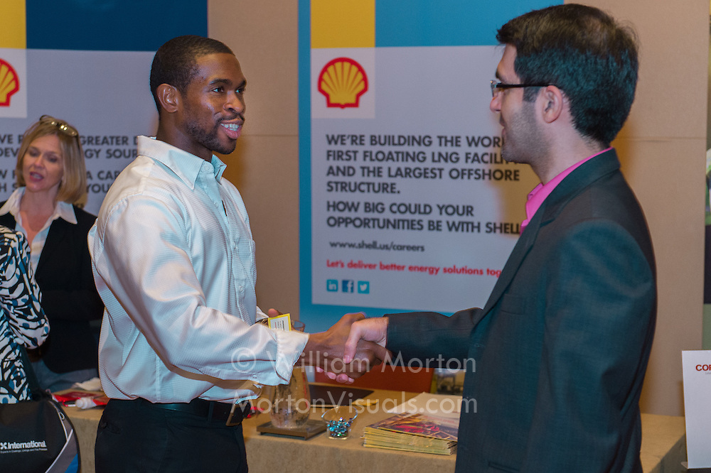 A representative from Shell's HR meets with career-seekers at the NACE BP Career Fair in San Antonio. Convention photography by Dallas event photographer William Morton of Morton Visuals event photography.