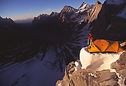 """The late American mountaineer Alex Lowe coils a rope during an ascent of """"The Bird"""" a peak in the Ak Su region of the Pamir Atlai Mountains, Kyrgyzstan."""