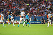Referee Cüneyt Çakır from Turkey is followed by Juventus players after decision during the Champions League Final between Juventus FC and FC Barcelona at the Olympiastadion, Berlin, Germany on 6 June 2015. Photo by Phil Duncan.