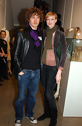 Model JADE PARFITT and TOBY BURGESS at 'A Night at Crumbland' an evening to celebrate the launch of the Stella McCartnry and Robert Crumb collaboration aand the publication of the R.Crumb handbook, held at Stella McCartney, 30 Bruton Street, London W1 on 17th March 2005.<br />