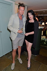 PERCY PARKER and AMY MOLYNEAUX at the 50th anniversary party for Daphne's restaurant, 112 Draycott Avenue, London held on 24th June 2014.