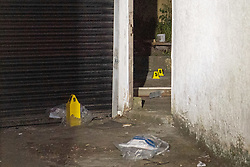 © Licensed to London News Pictures. 06/05/2020. London, UK. Evidence markers and a bag with unknown items.in an alleyway on Park Road. A Metropolitan Police officer has been assaulted after a vehicle pursuit in West Hendon. A man decamped from the vehicle and was located by an officer in an alleyway on Park Road. A struggle ensued, and the officer was seriously assaulted. The suspect fled the scene prior to police back up arriving. The man was located by police officers and arrested on suspicion of attempted murder. Photo credit: Peter Manning/LNP