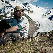 A prospecter rests high above the glaciers of northern British Columbia.