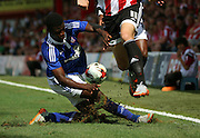 Ainsley Maitland-Niles tackling Phillip Hofmann and bringing half the pitch with him during the Sky Bet Championship match between Brentford and Ipswich Town at Griffin Park, London, England on 8 August 2015. Photo by Matthew Redman