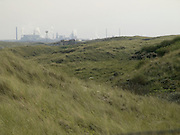 heavy industry seen from dune landscape Holland IJmuiden