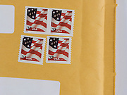 detail of envelope with 4 USA domestic stamps