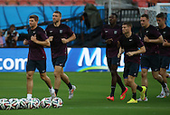 Steven Gerrard of England leads the England squad in the warm up during the England open training session at Arena da Amazonia, Manaus, Brazil. <br /> Picture by Andrew Tobin/Focus Images Ltd +44 7710 761829<br /> 13/06/2014
