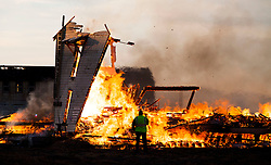 A 4-alarm fire burns down a large abandoned military barracks located on the north end of the former Mare Island Navy Base August 10, 2014.  Crews  and equipment from Crocket and Fairfield were on the scene to assist Vallejo firefighters.