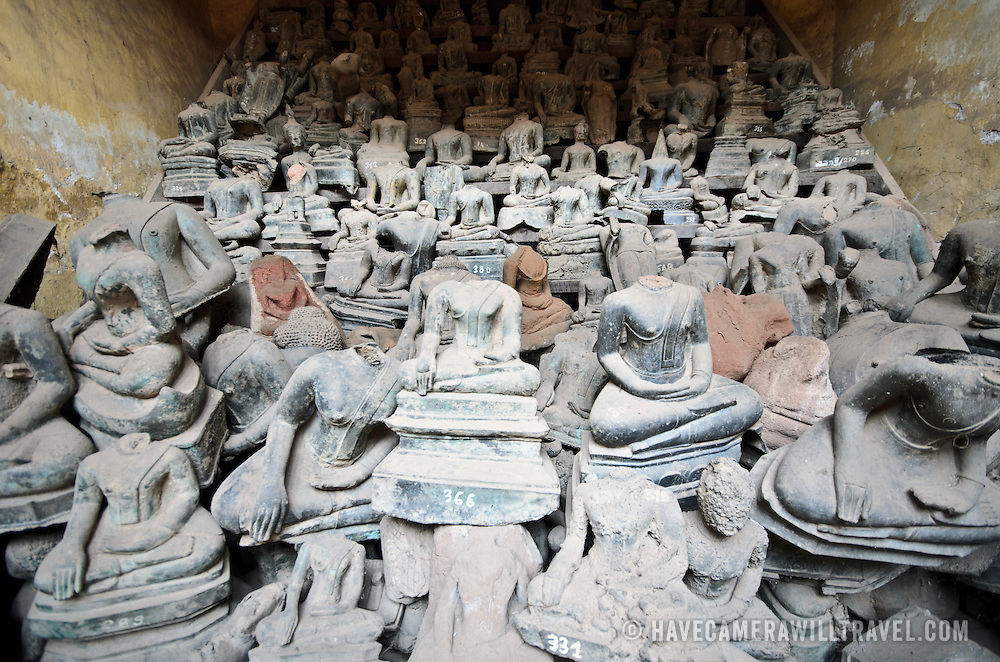 A room full of broken ceramic buddhas at Wat Si Saket in Vientiane, Laos. Built in 1818, the temple is of the Siamese style rather than the traditional Lao style. It is now perhaps the oldest temple still standing in Vientiane. These broken statues have been removed from the main collection of approximately 2000 ceramic and silver buddhas on display in the cloisters.