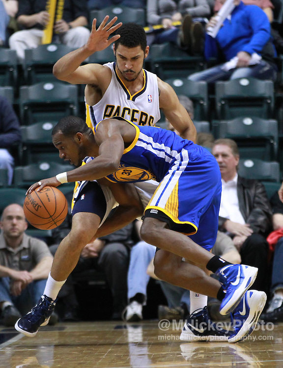 Feb. 28, 2012; Indianapolis, IN, USA; Golden State Warriors forward Chris Wright (33) dribbles around Indiana Pacers forward Jeff Pendergraph (29) at Bankers Life Fieldhouse. Indiana defeated Golden State 102-78. Mandatory credit: Michael Hickey-US PRESSWIRE