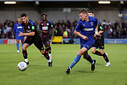 AFC Wimbledon Jack Rudoni (12) passing the ball during the Pre-Season Friendly match between AFC Wimbledon and Crystal Palace at the Cherry Red Records Stadium, Kingston, England on 30 July 2019.