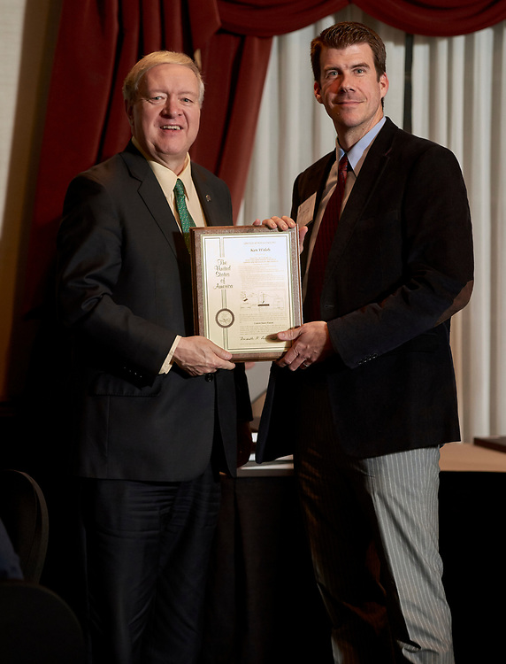 President Nellis presents Ken Walsh his patent award.