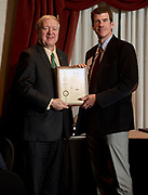 President Nellis presents Ken Walsh his patent award.