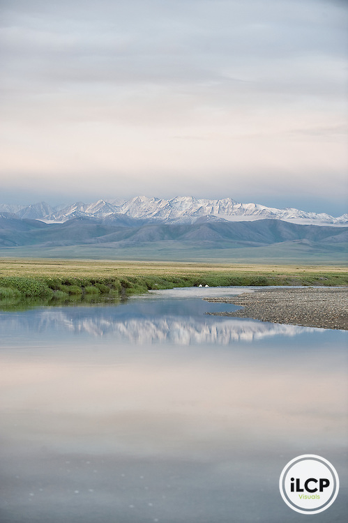 The Turner River flows down from the snow covered mountains of the Brooks Range. Image taken on Alaska's Arctic Coastline. Part of the Arctic National Wildlife Refuge this land is threatened by potential oil and gas development from the nearby Prudhoe Bay oil fields. ANWR is a critical nesting habitat for tens of thousands of birds and home to over 200 species.