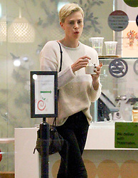 EXCLUSIVE: Charlize Theron satisfies her sweet tooth at Pinkberry Frozen Yogurt in Hollywood. Charlize was also accompanied by her daughters that sampled different flavors. Charlize wore a cream colored sweater, black skinny jeans and a Givenchy handbag for the outing. 13 Jan 2020 Pictured: Charlize Theron takes her daughters out for an evening to Pinkberry Frozen Yogurt in Hollywood. Photo credit: ROMA / MEGA TheMegaAgency.com +1 888 505 6342