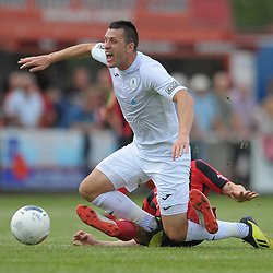 TELFORD COPYRIGHT MIKE SHERIDAN Aaron Williams is clattered from behind during the National League North fixture between Kettering Town and AFC Telford United at Latimer Park on Saturday, August 3, 2019<br /> <br /> Picture credit: Mike Sheridan<br /> <br /> MS201920-005