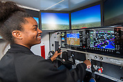 Aviation students fly high tech simulators at Sterling High School, September 5, 2014.
