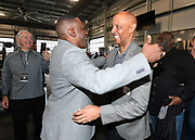 Jan 9, 2018; Alameda, CA, USA; Tim Brown (left) and James Lofton embrace at a press conference at the Raiders headquarters.