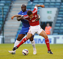 Bristol City's Marlon Pack battles with Gillingham's Adebayo Akinfenwa  - Photo mandatory by-line: Seb Daly/JMP - Tel: Mobile: 07966 386802 06/08/2013 - SPORT - FOOTBALL - Priestfield Stadium - Gillingham -  Gillingham V Bristol City - Capital One Cup - First Round