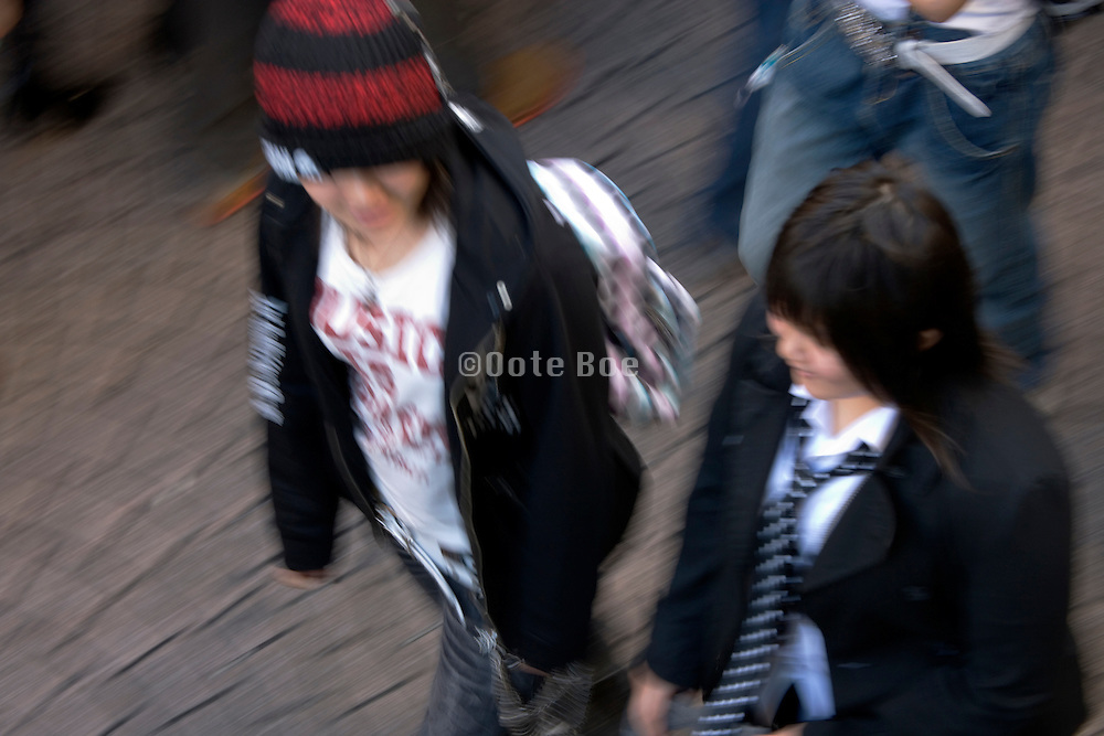 overhead view of young people walking around in the Harajuku district of Tokyo Japan