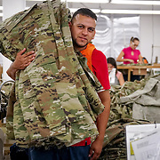 JUNE 28, 2016 --- COROZAL, PUERTO RICO<br /> Brian Oquendo Hernandez carries US Army pants in a production line at Bluewater Defense in Corozal. The company makes pants for the US Army.<br /> (Photo by Angel Valentin/Freelance)