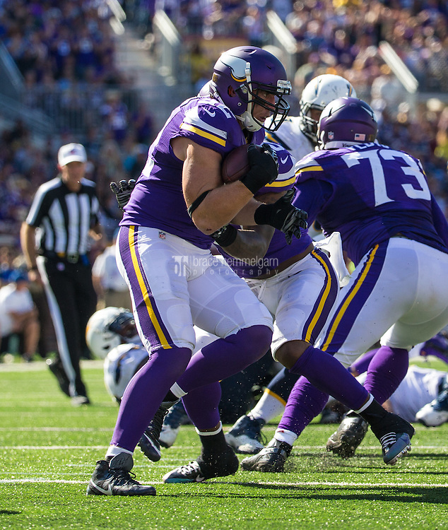 Sep 27, 2015; Minneapolis, MN, USA; Minnesota Vikings linebacker Chad Greenway (52) intercepts a pass and returns it for a touchdown during the fourth quarter against the San Diego Chargers at TCF Bank Stadium. The Vikings defeated the Chargers 31-14. Mandatory Credit: Brace Hemmelgarn-USA TODAY Sports