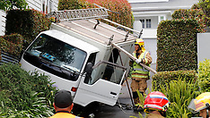 Auckland-Light truck ends up in bushes, Herne Bay