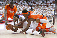 FAYETTEVILLE, AR - NOVEMBER 30:  Coty Clarke #4 of the Arkansas Razorbacks dives for a loose ball on the floor during a game against the Syracuse Orangemen at Bud Walton Arena on November 30, 2012 in Fayetteville, Arkansas.  The Orangemen defeated the Razorbacks 91-82.  (Photo by Wesley Hitt/Getty Images) *** Local Caption *** Coty Clarke Sports photography by Wesley Hitt photography with images from the NFL, NCAA and Arkansas Razorbacks.  Hitt photography in based in Fayetteville, Arkansas where he shoots Commercial Photography, Editorial Photography, Advertising Photography, Stock Photography and People Photography