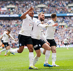 Peterborough Midfielder Josh McQuoid (NIR) (centre) celebrates scoring the opening goal - Photo mandatory by-line: Rogan Thomson/JMP - 07966 386802 - 30/03/2014 - SPORT - FOOTBALL - Wembley Stadium, London - Chesterfield FC v Peterborough United - Johnstone's Paint Trophy Final.