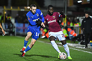 West Ham United defender Arthur Masuaku (26) and Wimbledon defender Dylan Connolly(16) battle for the ball during the The FA Cup fourth round match between AFC Wimbledon and West Ham United at the Cherry Red Records Stadium, Kingston, England on 26 January 2019.