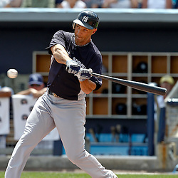 March 21, 2012; Port Charlotte, FL, USA; New York Yankees left fielder Raul Ibanez (27)  hits a fly out against the Tampa Bay Rays during the top of the second inning of a spring training game at Charlotte Sports Park.  Mandatory Credit: Derick E. Hingle-US PRESSWIRE